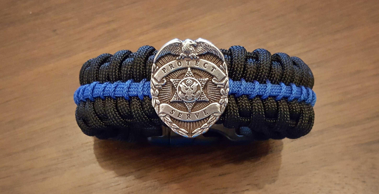 Thin Blue Line Medallion Edition Paracord Survival Bracelet Click To Enlarge